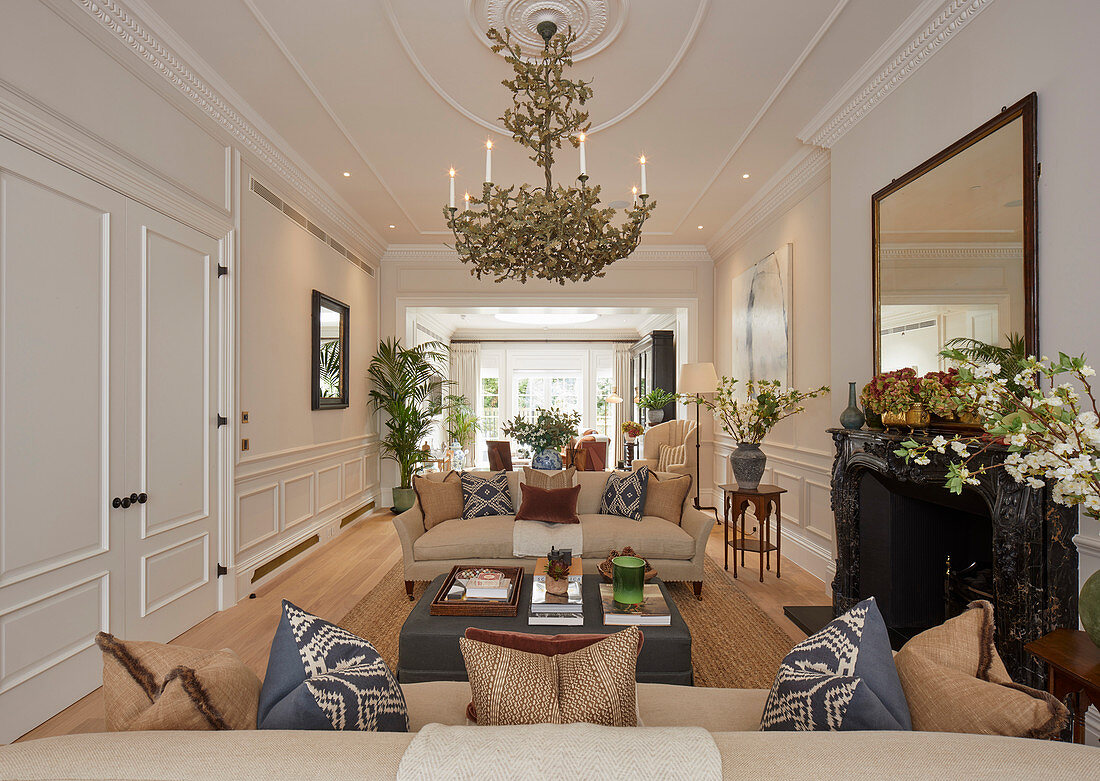 Elegant living room with panelled walls and stucco ceiling