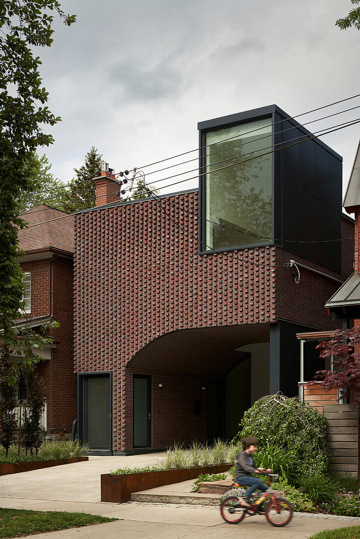 Modern brick house with integrated carport