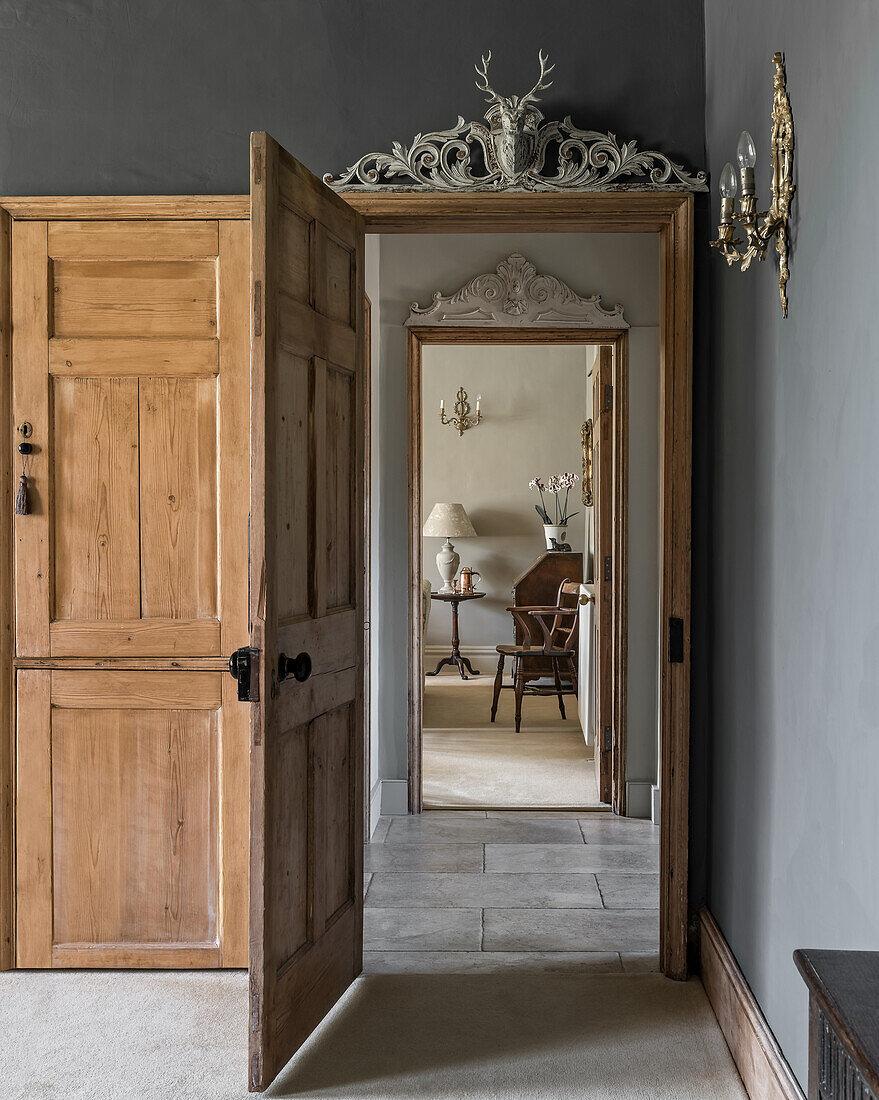View through wooden doorway in restored farmhouse