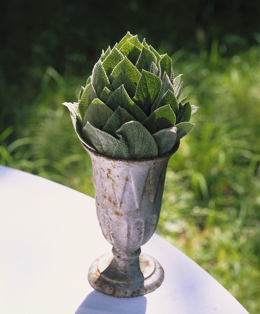 Small goblet filled with leaves in shape of an artichoke