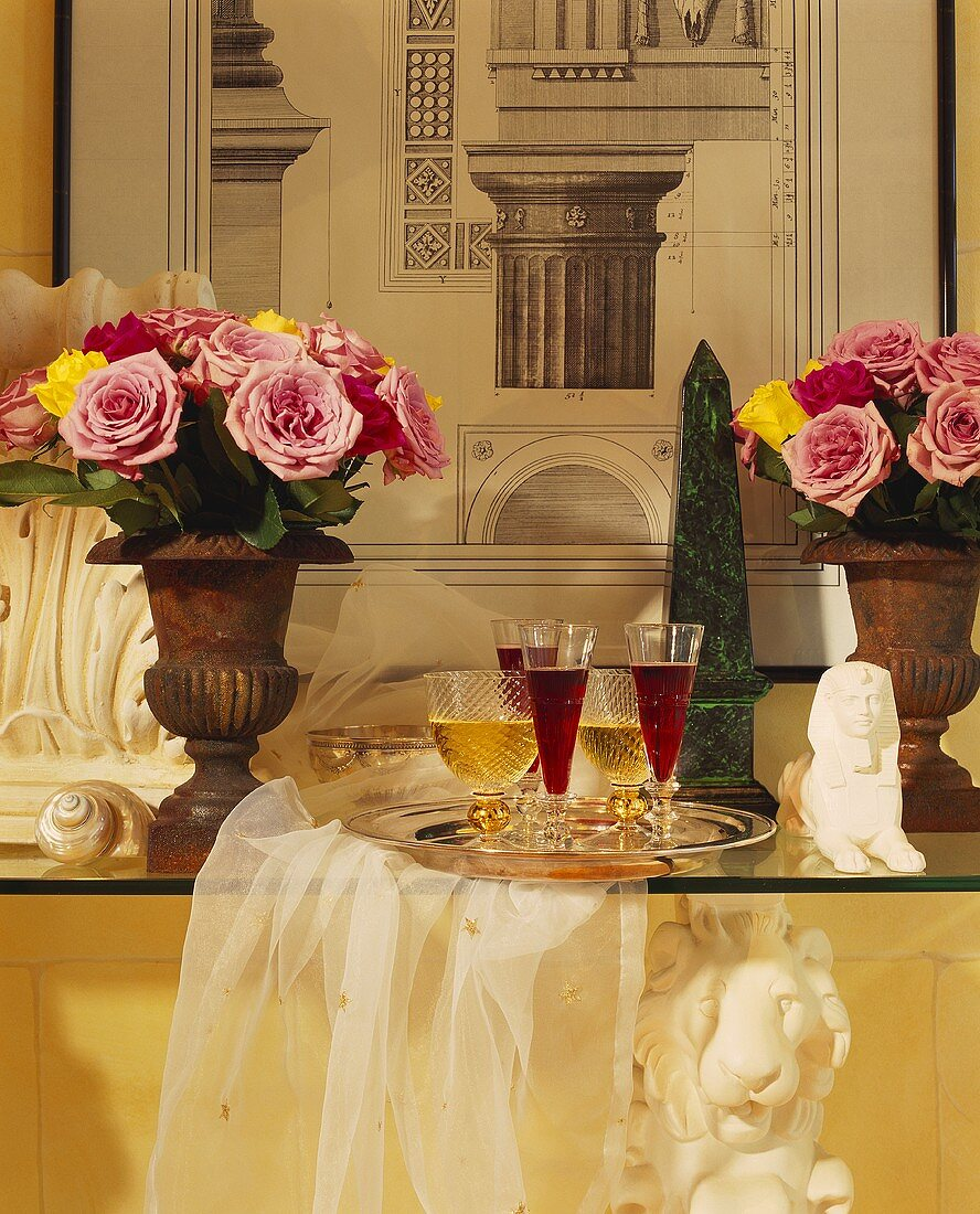 Two bouquets of roses in goblets