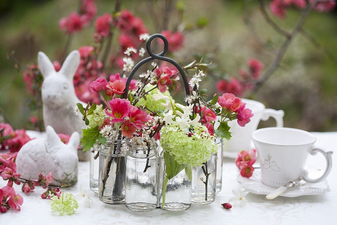 Foral decoration (japonica and hyacinths) on a table decorated for Easter