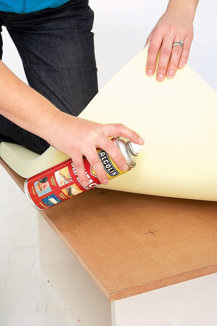 Making an upholstered stool (Sticking foam rubber on box lid)