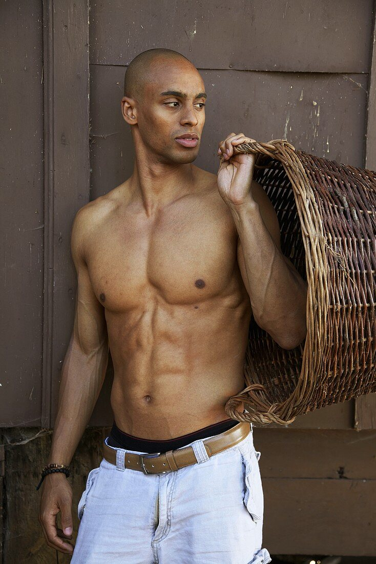 Young man with wicker basket