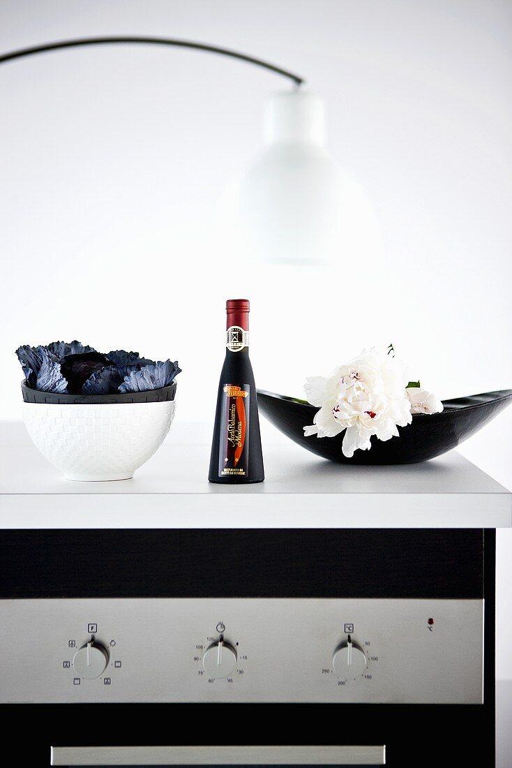 A bottle of balsamic vinegar in a kitchen