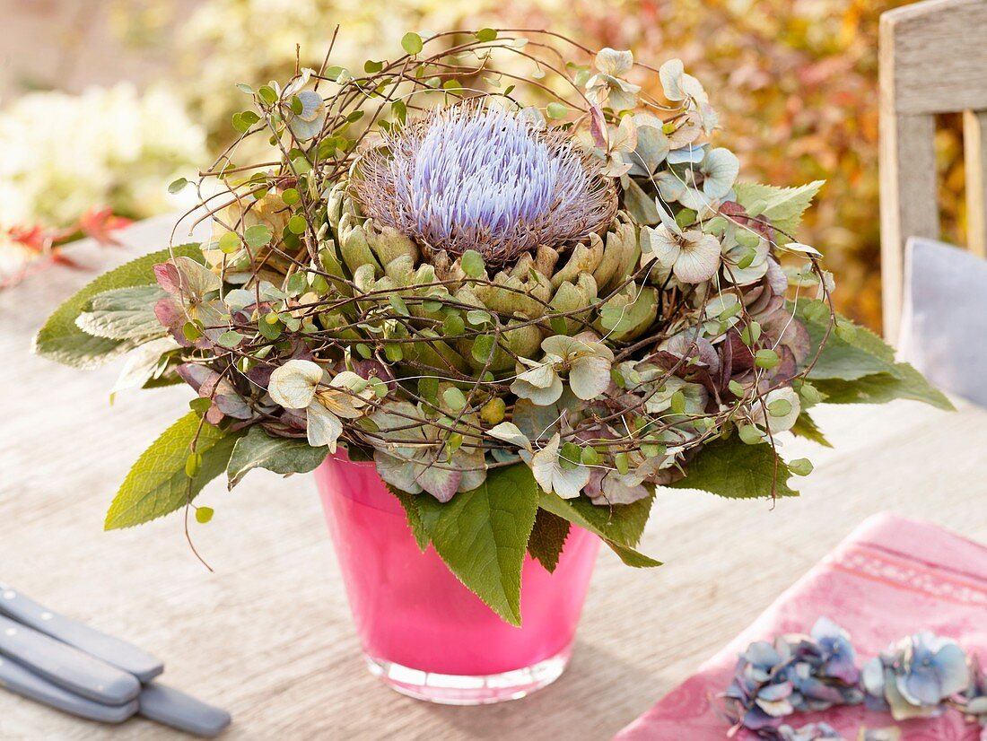 Hydrangeas and artichoke flower in vase