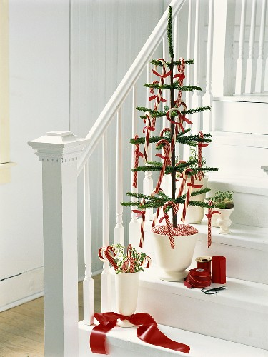 Artifical Christmas tree with candy canes on staircase