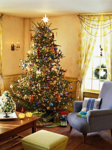 Richly decorated Christmas tree and gifts in living room