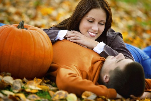 A young couple lying on leaves
