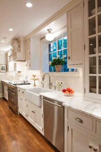 Spacious country-house kitchen with modern, stainless steel fitted appliances