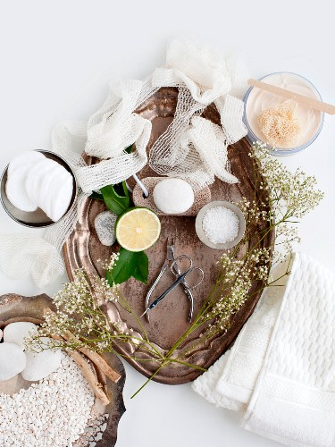 Cosmetic products and stones on silver trays