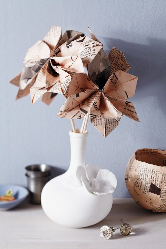 Bouquet of origami newspaper flowers and newspaper dish
