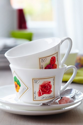 Teacups decorated with floral postage stamps