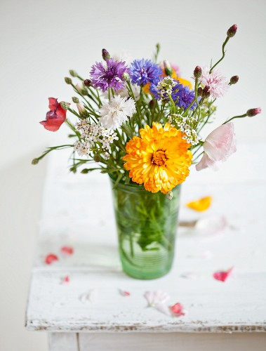 Summery posy in drinking glass