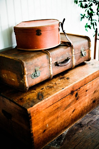Stack of vintage cases on wooden trunk