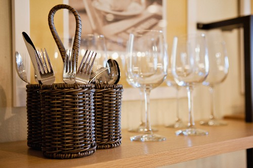 Close-up of cutlery and wine glasses on shelf; San Marcos; California; USA