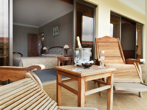 Wooden lounge chairs on balcony of hotel room