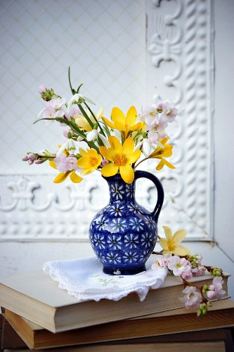 Spring posy of cherry blossom, crocuses & snowdrops in blue vase