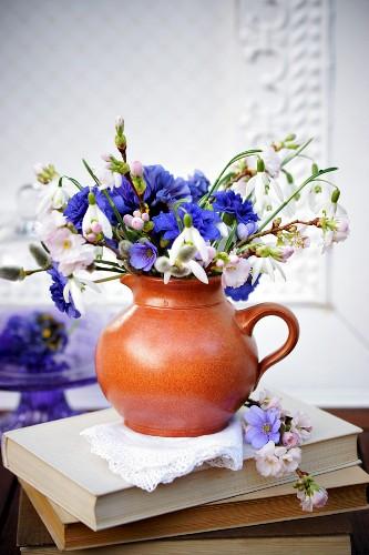 Spring posy of liverwort flowers, snowdrops & cherry blossom