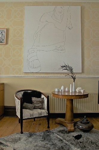 Drawing of woman above art nouveau armchair and small china vases on antique side table