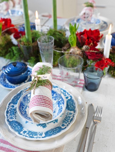 Blue and white place setting with napkin on festively set table