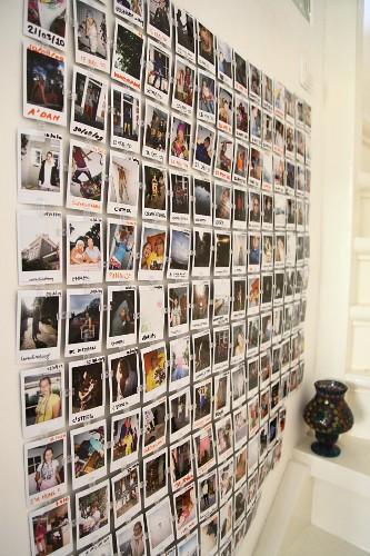 Wall collage of Polaroid souvenir photos