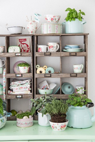 Vintage dresser with utensils and kitchen herbs in wooden top section