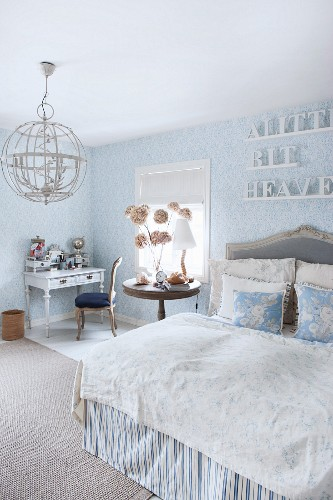 Romantic bedroom in pale blue and white with old-world ambiance