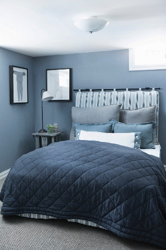 Elegant bedroom in shades of blue with vintage-style traditional ambiance