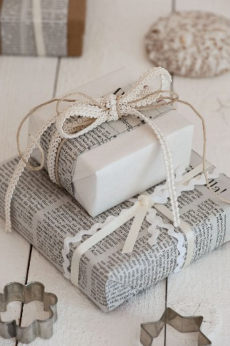 Gifts festively wrapped in newspaper and ribbons