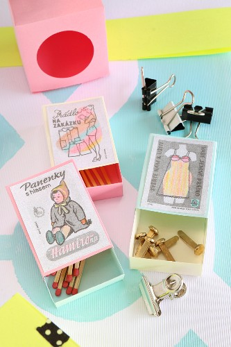 Small, hand-crafted boxes decorated with painted labels