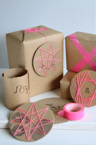 Hand-crafted, circular cardboard decorations with patterns of thread