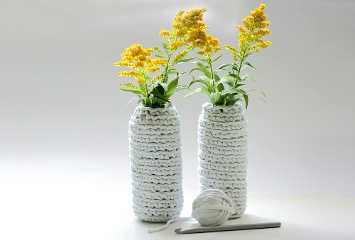 Vase covers crocheted from strips of fabric
