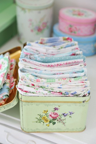 Vintage tin with floral pattern for storing scraps of pastel fabrics