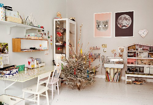 White, Scandinavian-style furniture and decorated Christmas tree on white-painted wooden floor in teenager's bedroom
