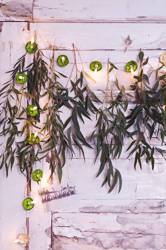 A garland made from ice cup cases, fairy lights and eucalyptus sprigs