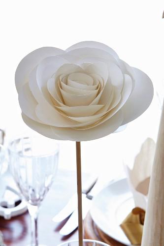 Elegant, white paper rose as festive table decoration
