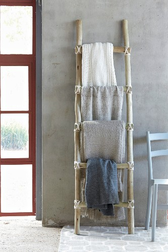 DIY, ladder-style towel rail made from rough branches