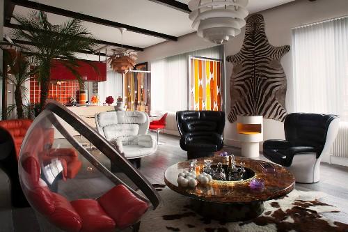 Elegant retro-style lounge area with zebra skin on wall in open-plan interior