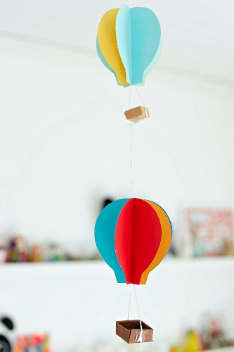Mobile of hand-made colourful paper hot-air balloons