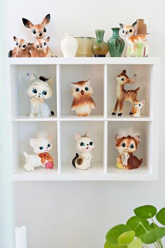 Retro animal figurines in white display case