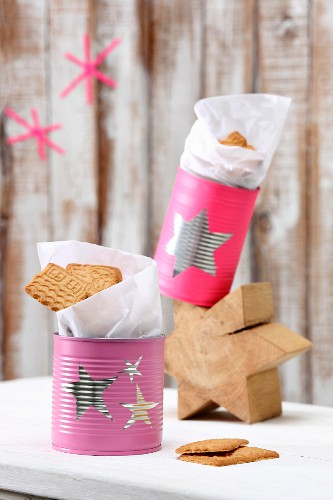 Tin cans painted with stars used as biscuit tins