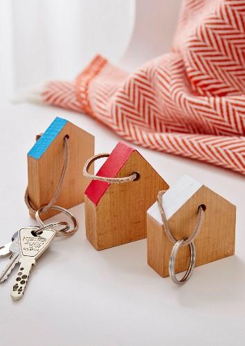 Homemade, house-shaped wooden keyrings