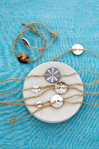 Bracelets hand-crafted from hemp cord and various buttons decoratively arranged