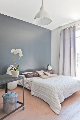Elegant bedroom in soft earthy shades with grey wall