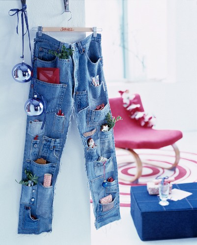 Advent calender made from pair of jeans with pockets sewn onto legs