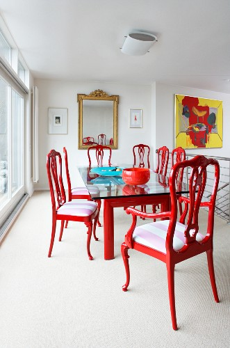 Dining table with red chairs and a glass top table