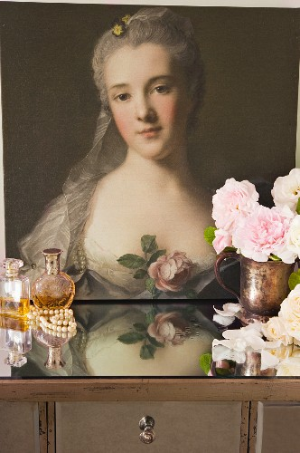 Baroque portrait of a woman behind perfume flagons and cut roses in brass pitcher