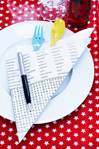 Cutlery on plate in pocket made from puzzle page