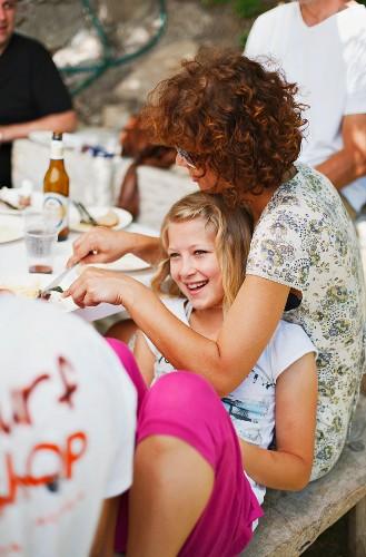Family a friends eating al fresco